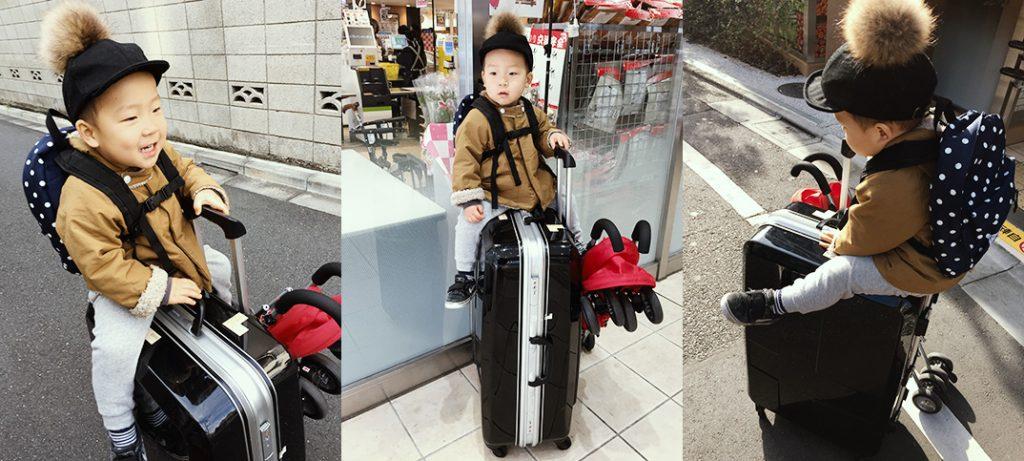 スーツケースに乗る子ども