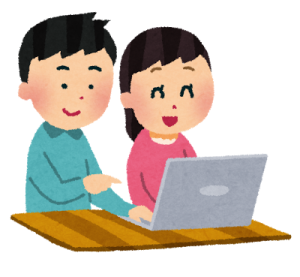 夫婦でパソコンに向かい合う