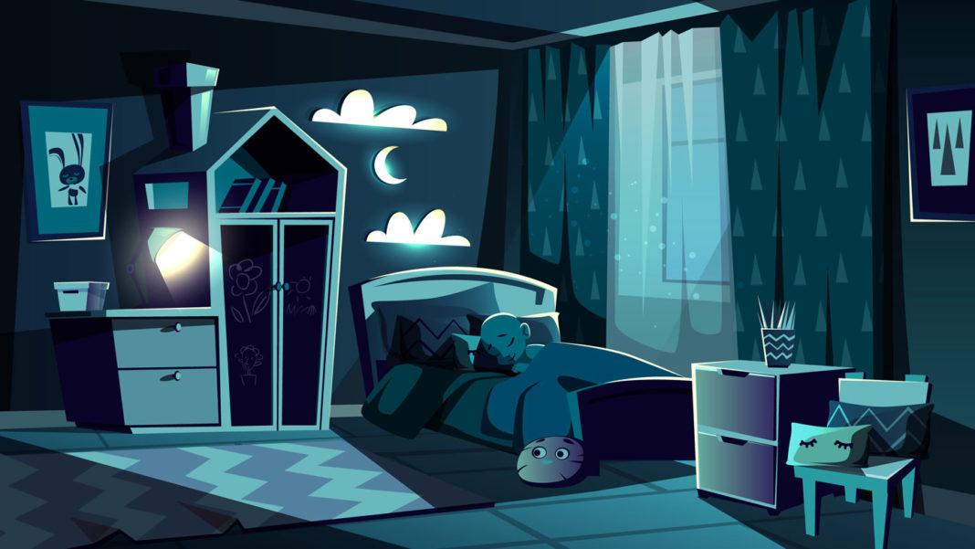 夜、部屋のベッドで眠っている